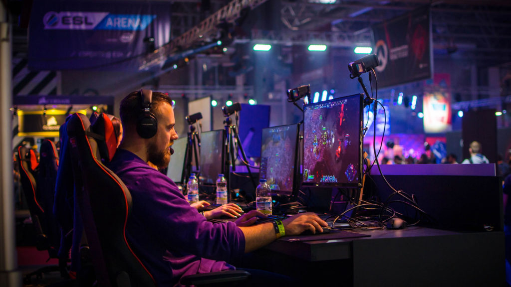 A pro gamer playing a video game live at an esports tournament