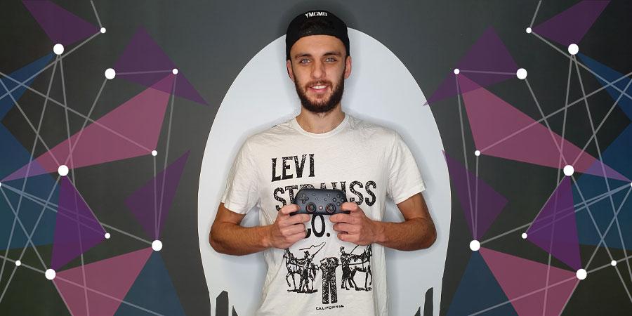 DJ Oli in front of Ghost logo