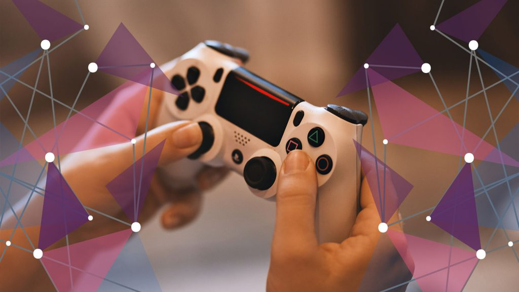 Gamer holding white Playstation controller